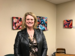 Renee Walden of Edward Jones with the work of Esther Loopstra