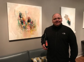 Owner Ben Viscon with Amy Stone's work at Viscon Cellars