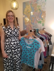 Heather Brinko and #ArtWillSaveYou merch at the Office of Rebecca Mitsui