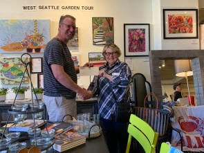 Winner Sheila Lengle of West Seattle Garden Tour Art Competition with WSGT president Laird Applegate at Capers Home