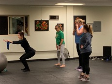 Candice Rose demonstrating proper technique to a class at Rosefit
