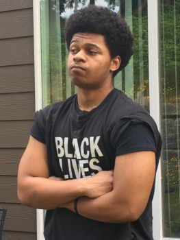 """Jaymin Brown, high school junior and son of artist Jasmine Iona Brown, has modeled for his mother's photo mural series """"Black Teen Wearing Hoodie"""" that was displayed in the Delridge, Capital Hill and South Lake Union neighborhoods."""